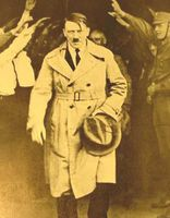 Adolf_Hitler_walking_out_of_Brown_House_after_1930_elections