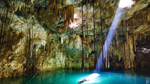 cave light beam azure lake stalactites stalagmites